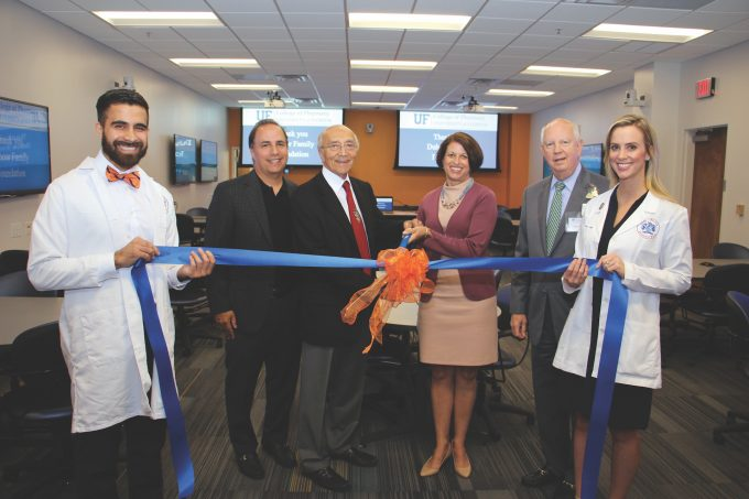 A ribbon-cutting ceremony on Oct. 10 marked the grand opening of the DuBow Family Foundation Interactive Classroom in Jacksonville. Pictured are, l to r, Juan Castellanos, a first-year pharmacy student, Michael and Lawrence DuBow, from the DuBow Family Foundation, Julie Johnson, dean of the College of Pharmacy, Russell Armistead Jr., chief executive officer of UF Health Jacksonville, and Ashlan Kunz, a second-year pharmacy student.