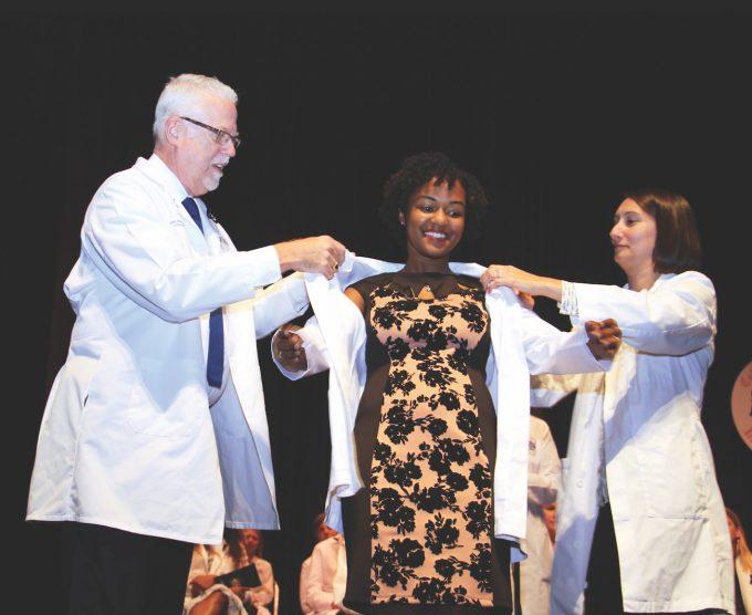 Pharmacy student receives her white coat
