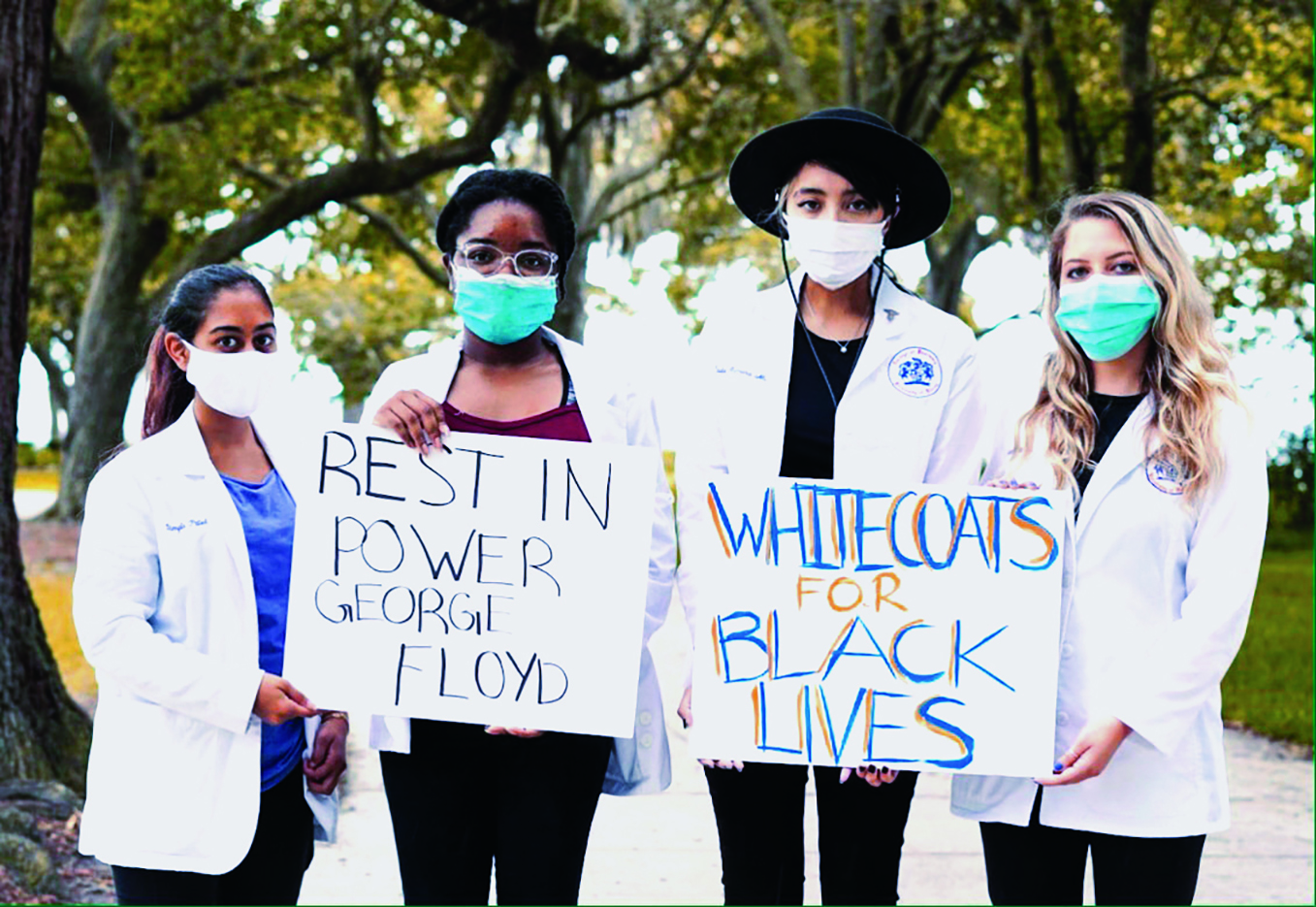 Jacksonville pharmacy students Dimple Patel, Moya Reid, Jade Nanan and Nicole Rossi participated in the White Coats for Black Lives event.